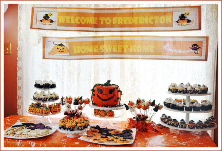 Halloween party dessert table with Jack O Lantern cake and goodies