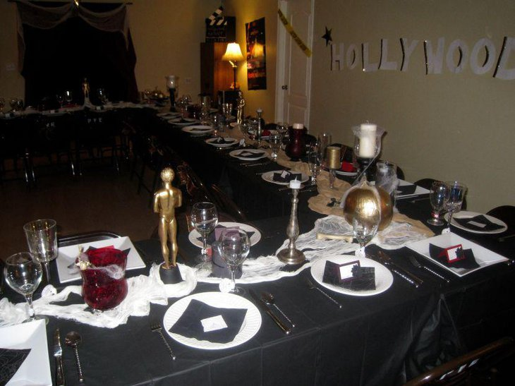 Halloween party table decor with Hollywood theme in golden accents