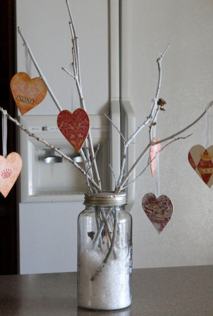 Homemade Valentines jar with branches and paper hearts centerpiece