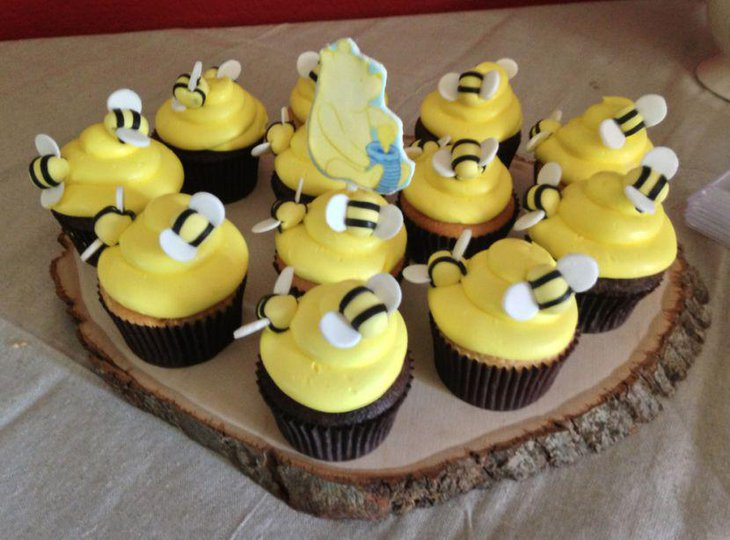 Hunny vanilla cupcakes on Winnie The Pooh baby shower table 1
