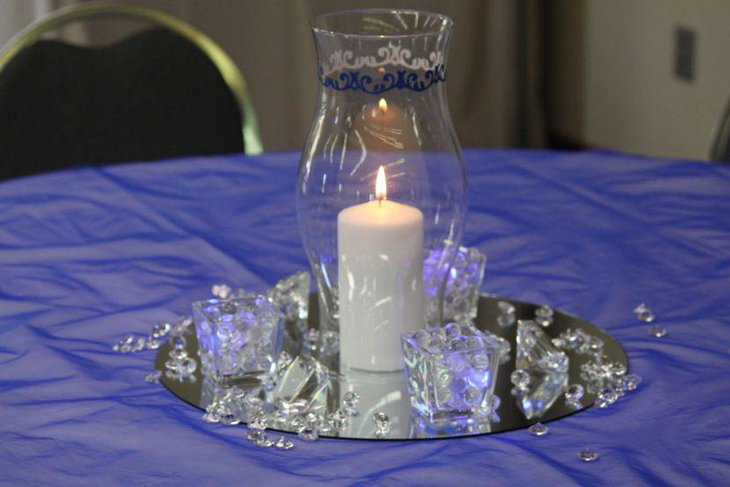 Impressive wedding party table setting with hurricane vase candle and crystals