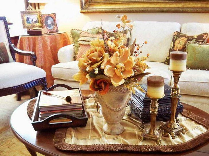 Innovative coffee table decor with brass candleholders and flower vase