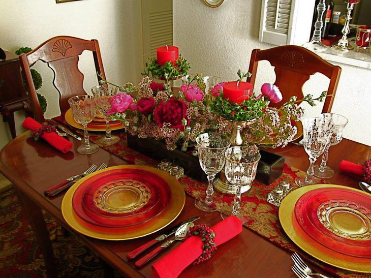 Inspirational formal dinner party table setting in red and golden tones