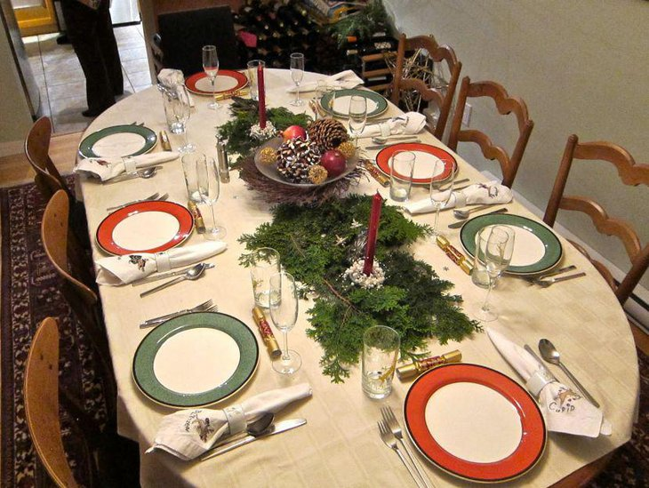 Inspiring Christmas table setting with pines and greens