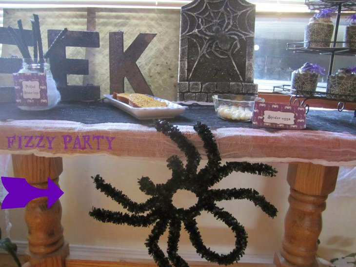 Kids Halloween table decor with a creepy crawly spider