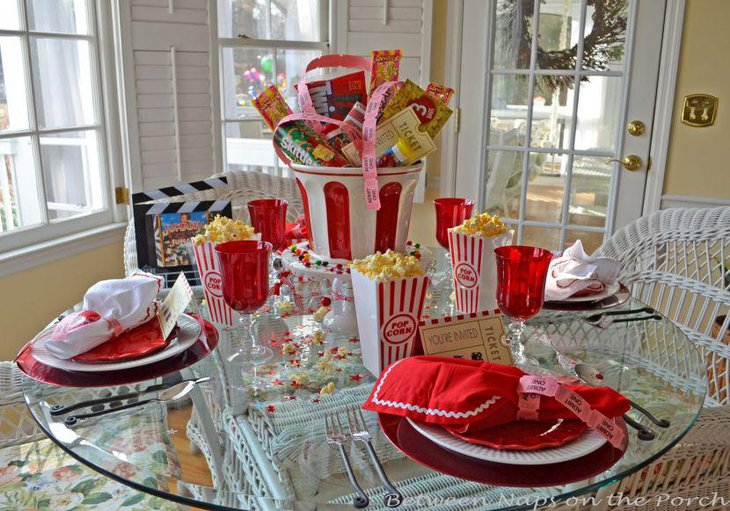 Kids Movie Night party table decorations using red and white colour palette