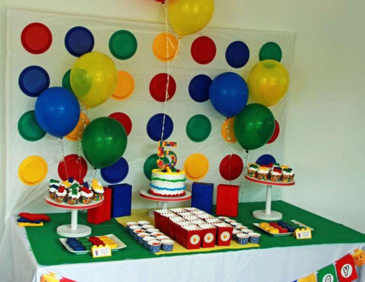 Lego inspired cake and cookies as party table centerpieces