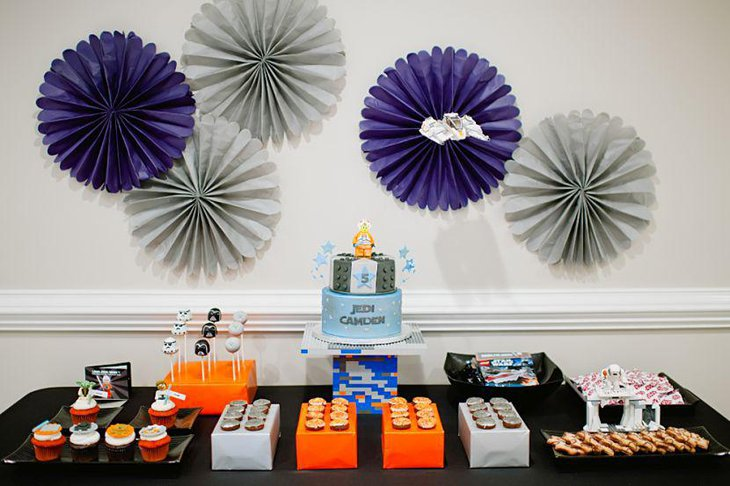 Lego Star Wars inspired birthday party decor in orange white and black color