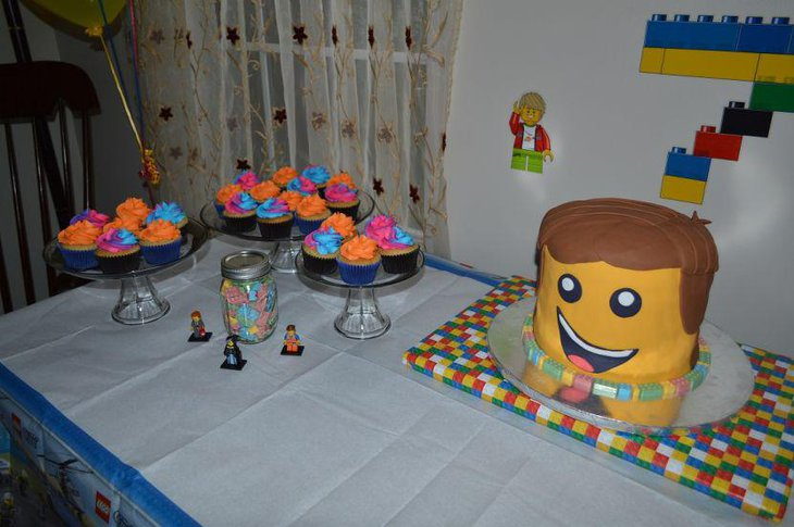 Lego themed party table setting with Emmet cake and Lego figurines