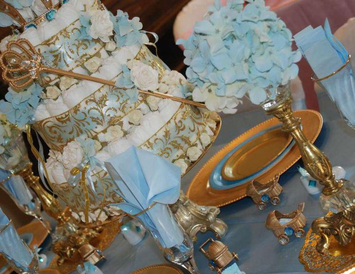 Little prince and princess themed twin baby shower table in golden accents