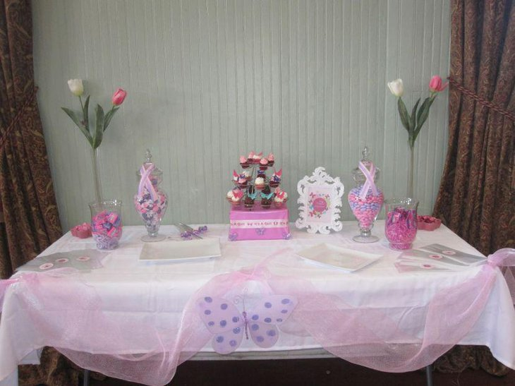 Lovely pink butterfly themed baby shower table