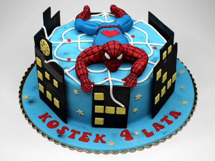 Lovely Spiderman cake with Spiderman on top of it