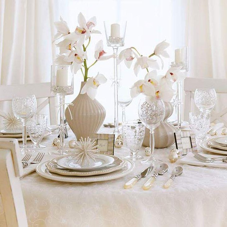 Magnificent White Floral Arrangements In Cream Vases For Christmas Table