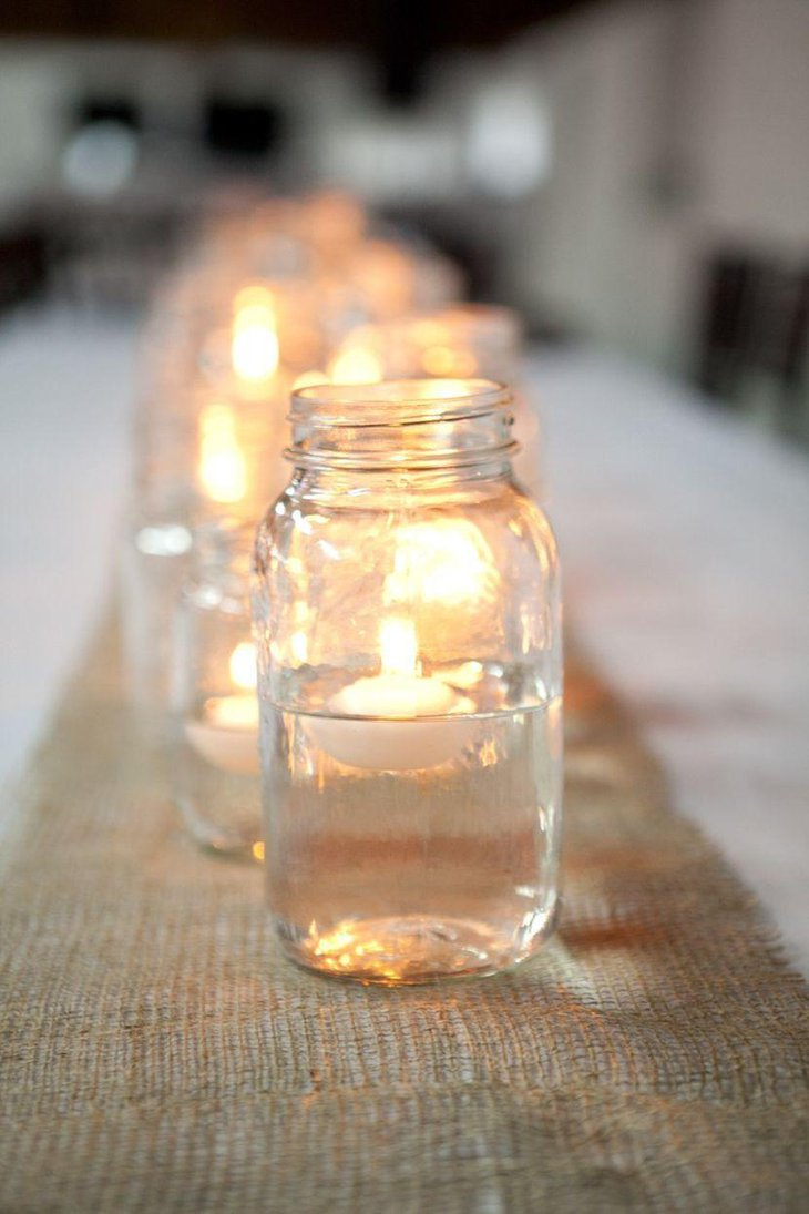 Mason jar candle centerpieces on wedding table