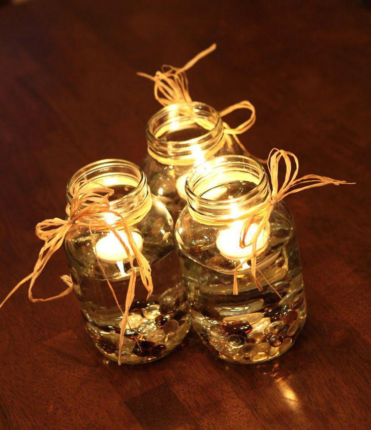Mason jar decorated with stones and lights for eccentric wedding centrepiece