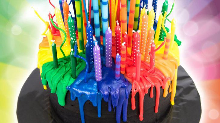 Melting candle rainbow themed birthday cake