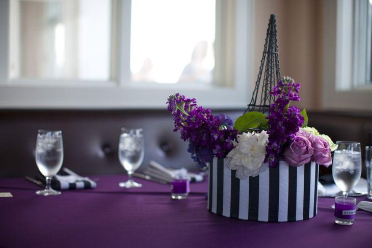 Mesmerizing Parisian themed spring wedding table decor in purple