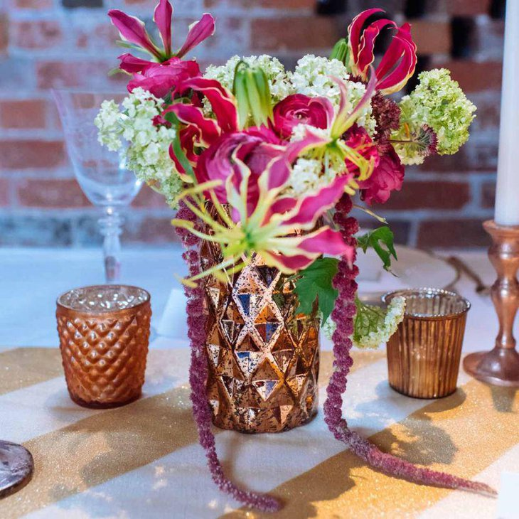 Metallic copper vase floral centerpiece on spring table