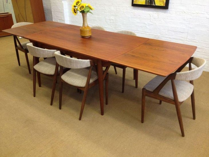 Mid century wooden table with white chairs