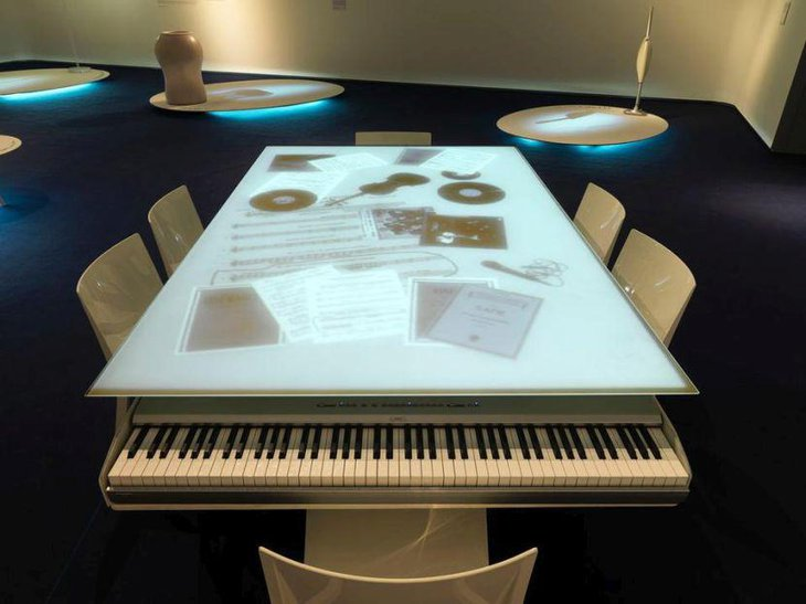 Modern dinner table with integrated piano