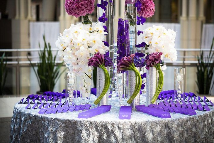 Modern purple themed wedding reception escort card table
