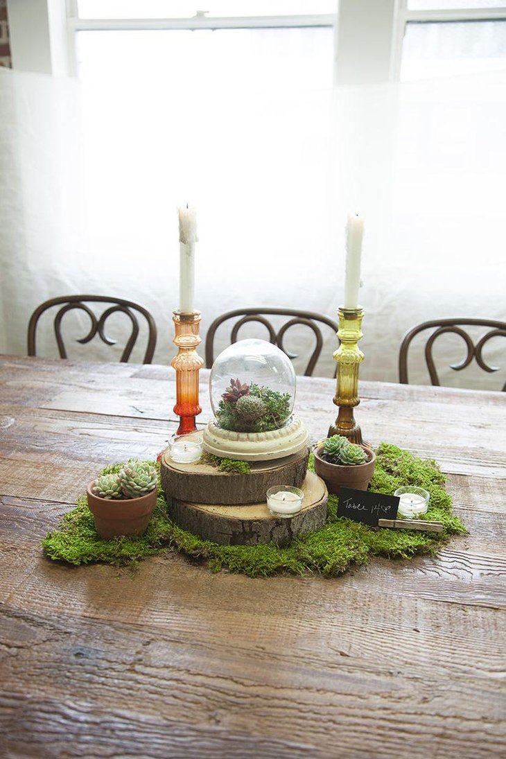 Moss and candle spring table centerpiece