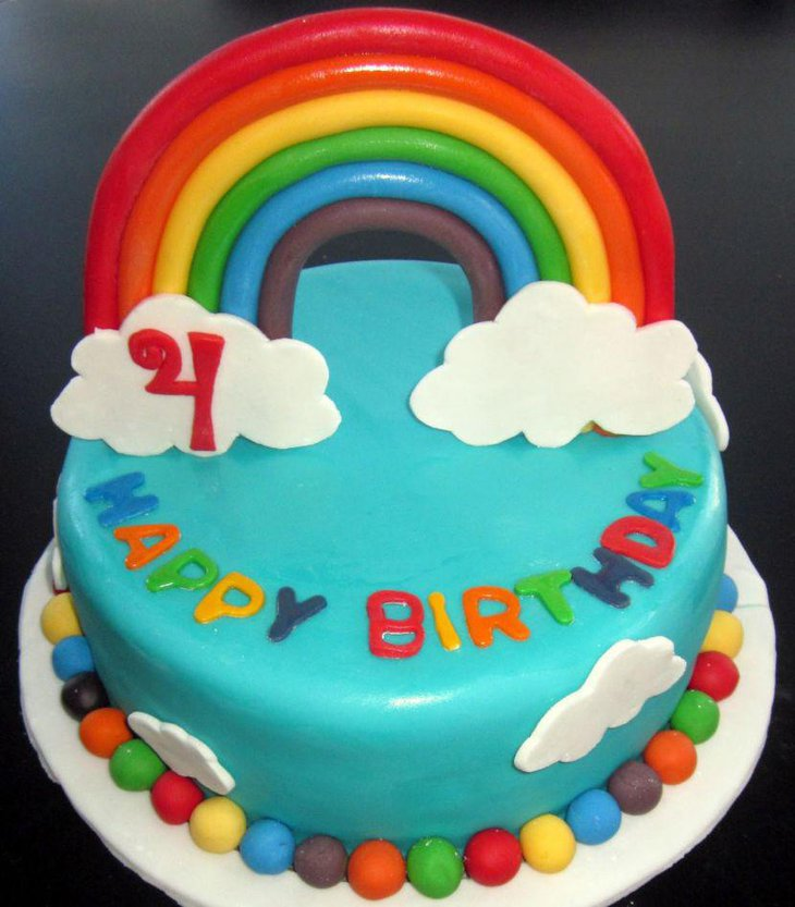Multicolored rainbow themed birthday cake