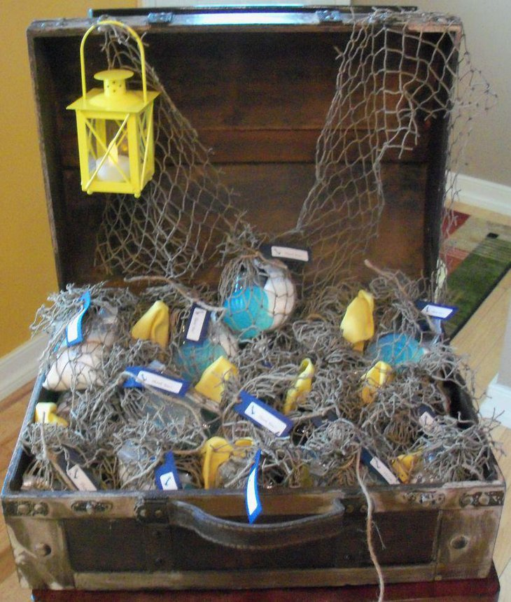 Nautical baby shower table decor with treaure chest lantern and net