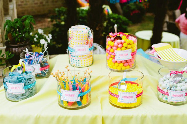 Neon accented candy decor on summer birthday table