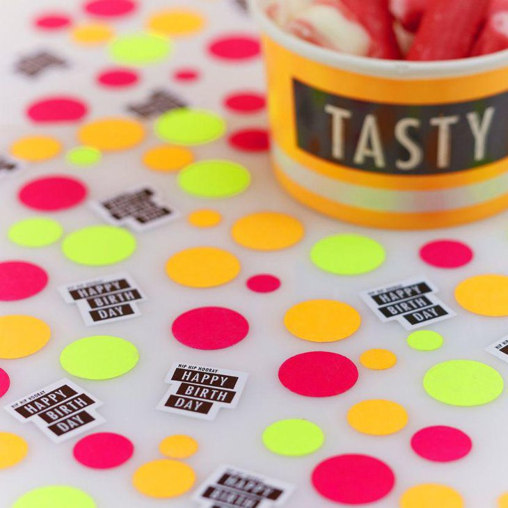 Neon themed birthday table decor with confetti