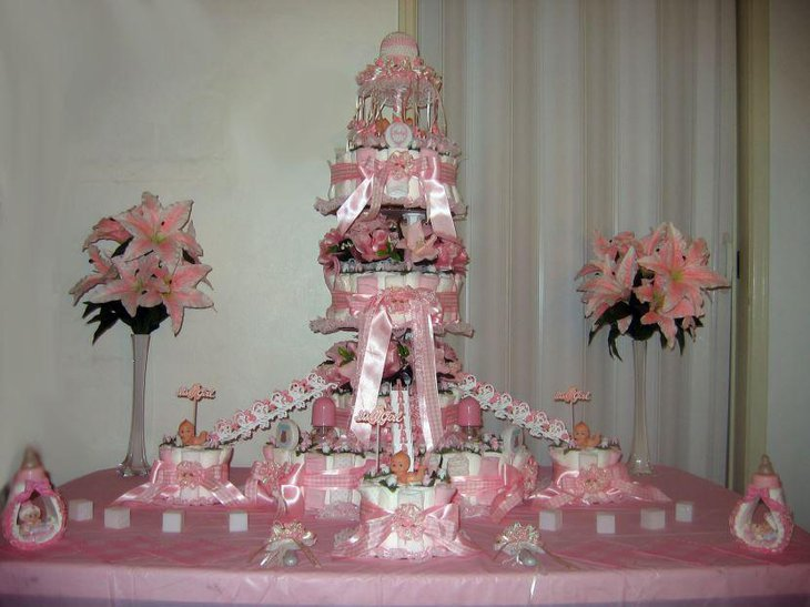 Pacifiers. Little babies Pink ribbons. This diaper cake has got it all