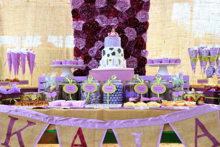 Party dessert table decoration with purple