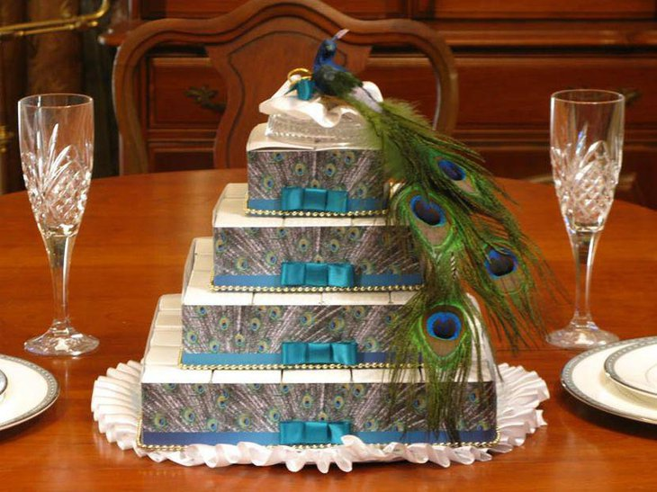 Peacock favor box centerpiece on a wedding table