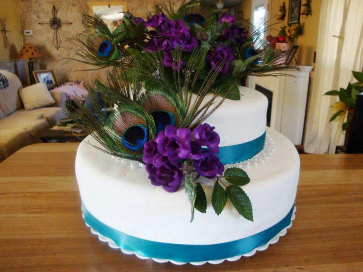 Peacock feathers and purple floral centerpiece
