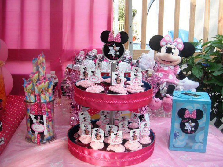 Pink accented Minnie Mouse candy buffet tablescape