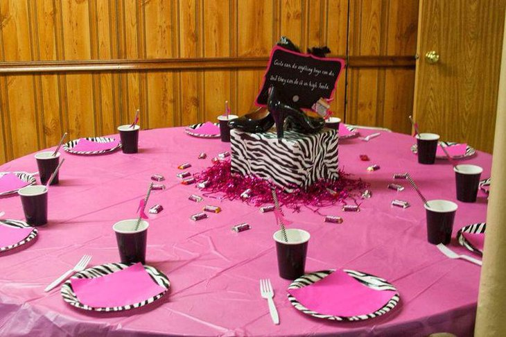 Pink and black adult birthday table with a show quote