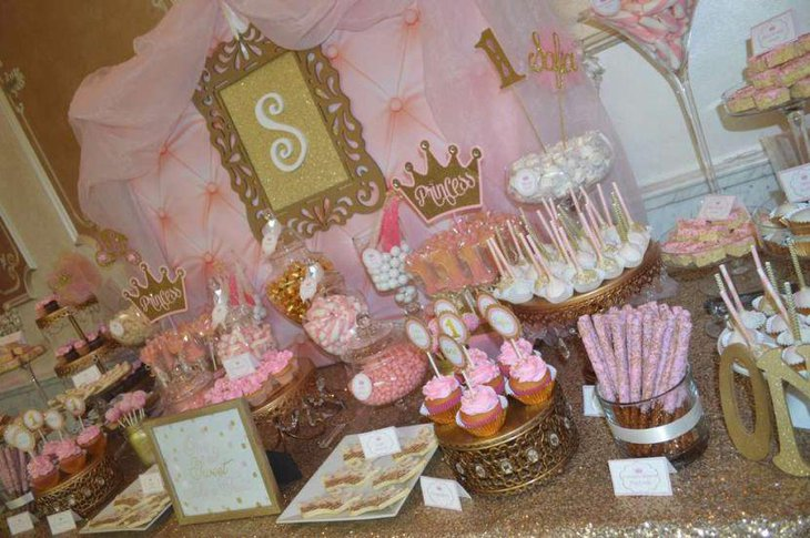 Pink and gold Princess themed baby shower candy table