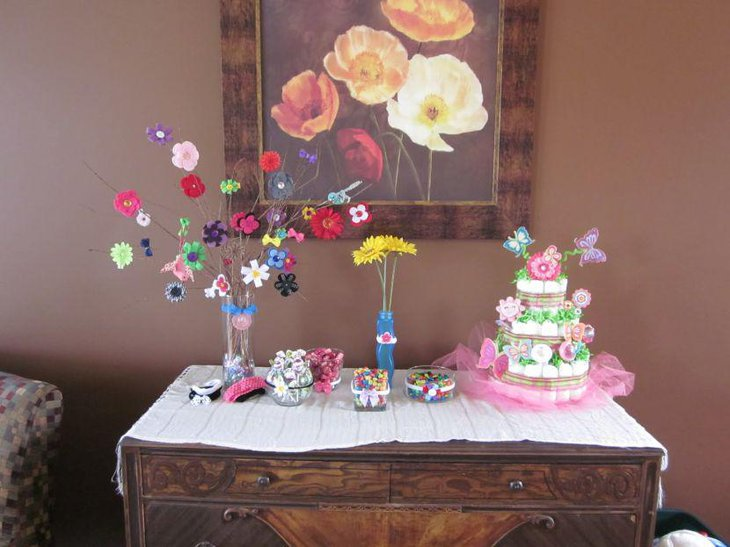 Pink and purple butterfly diaper centerpiece on baby shower table