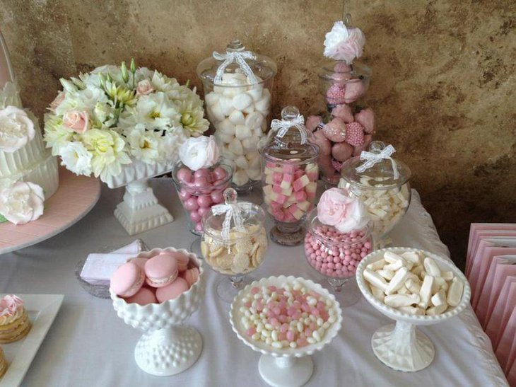Pink and white dessert table decor for an engagement party