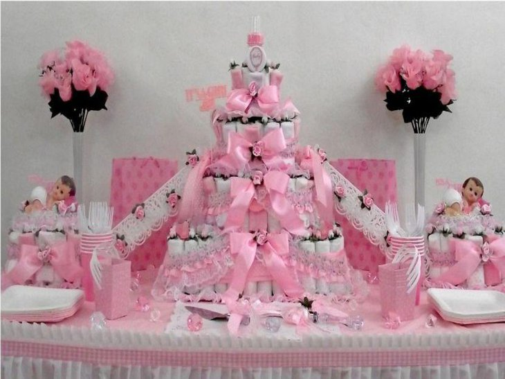 Pink and white diaper cake for twins