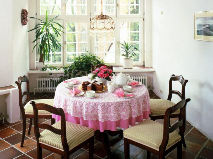Pink floral decor on a small breakfast table