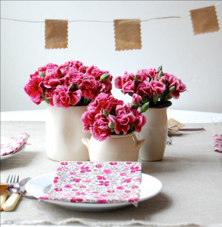Pink flower decor on kids birthday table