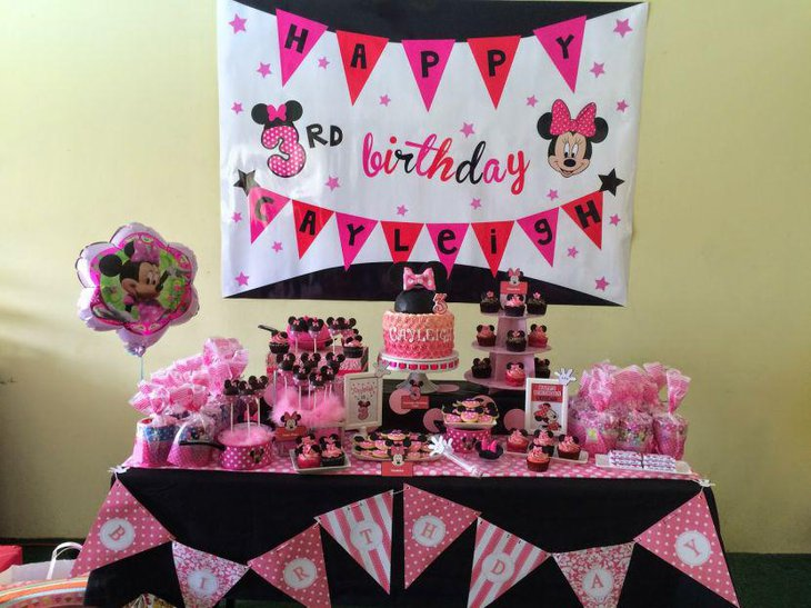 Pink Minnie Mouse themed candy buffet tablescape