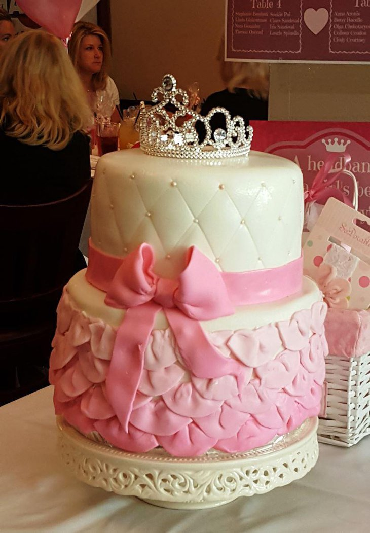 Pink princess baby shower cake with a tiara on top