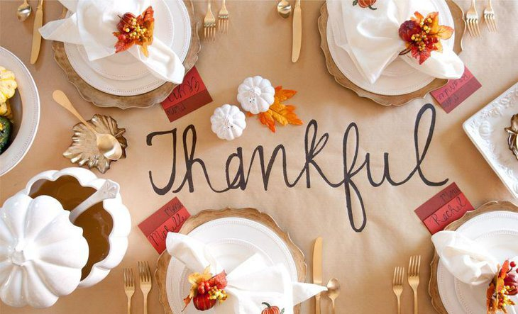 Plain brown paper Thanksgiving table runner with Thankyou message written on it