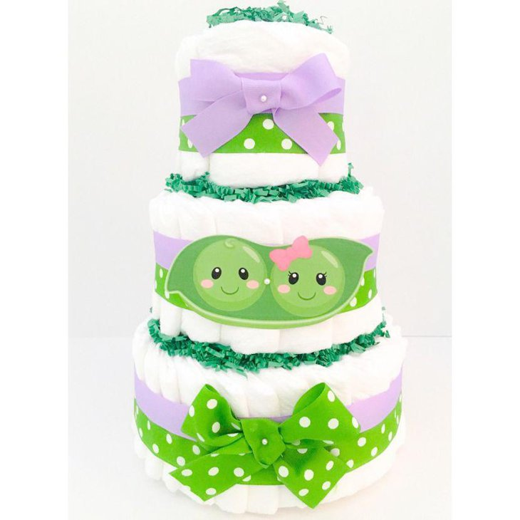Polka dotted two peas in a pod themed twin diaper cake