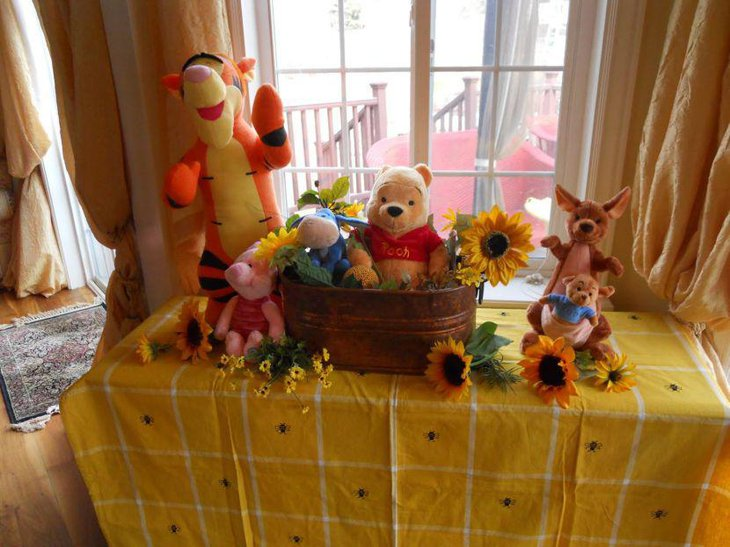 Pooh in the basket centerpiece for Winnie The Pooh baby shower table