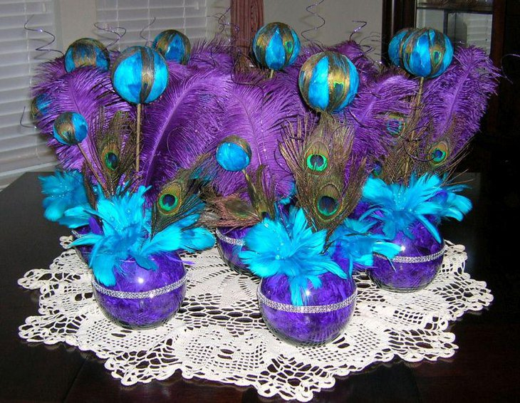 Purple and turquoise peacock feather centerpieces