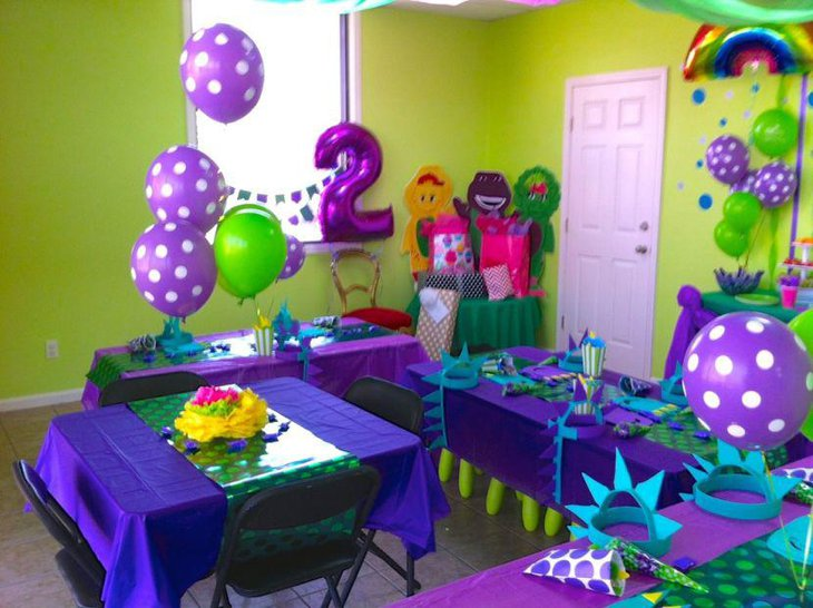 Purple balloon decorations on party table
