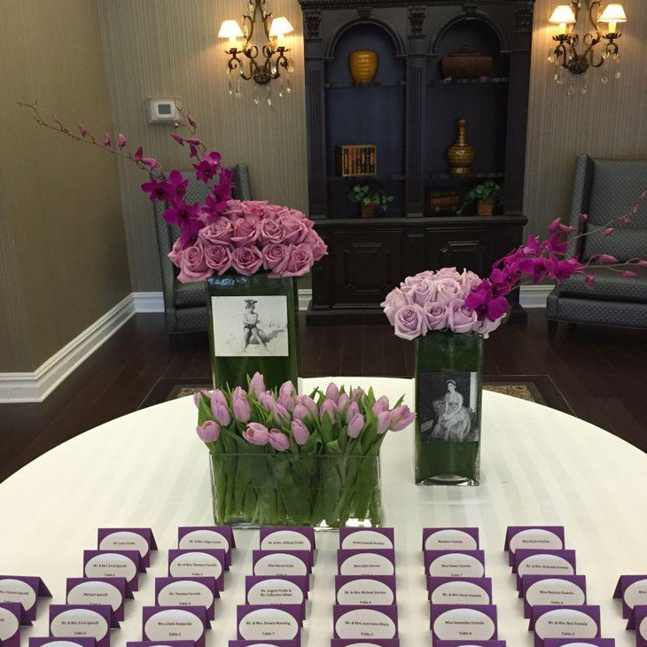 Purple floral centerpiece on 80th birthday table